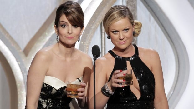 Tina Fey, left, and Amy Poehler will return to host the 2014 and 2015 editions of the annual Golden Globe Awards, which celebrate American film and TV achievements.