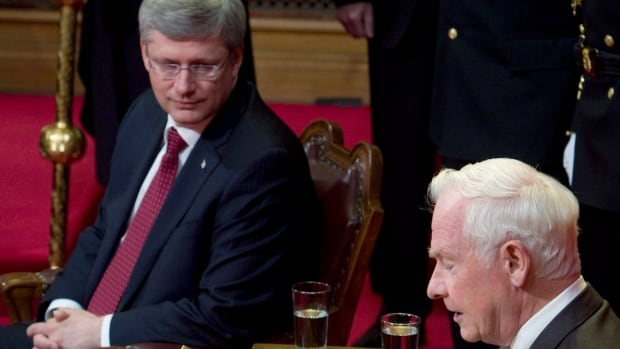 Prime Minister Stephen Harper looks on as Gov. Gen. David Johnston delivers the throne speech in the Senate Chamber on Parliament Hill on June 3, 2011. This year, Harper is trying to put the focus on consumer issues in what is likely the last throne speech before a scheduled 2015 election. Many people are watching for him to use the speech to reset the agenda and try to take the focus off of recent scandals.