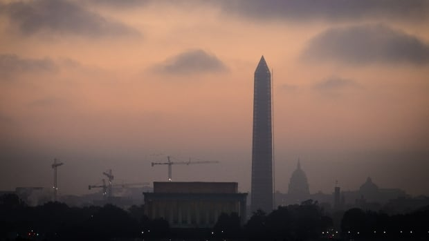 Low clouds and fog roll across Washington at sunrise Tuesday as Congress continues to negotiate their way free from the budget standoff.