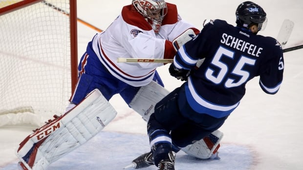 Montreal Canadiens' goaltender Carey Price launches Winnipeg Jets' Mark Scheifele after Scheifele skated into the crease during a game in October 2013.