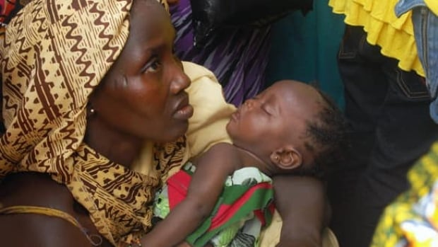A woman and child attend the launch of a program to provide free medical care to pregnant and breastfeeding women and to children under five, in Freetown, Sierra Leone, in April 2010.