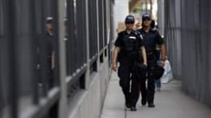 tp-toronto-100626-reuters-police-patrolling-security-fence-banner