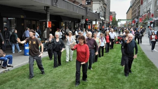 Members of the Taoist Tai Chi Society demonstrate their practice on a grassed-over Ste-Catherine Street during Montreal's Car-Free Day in 2010.