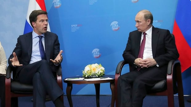 Russian President Vladimir Putin, right, and Dutch Prime Minister Mark Rutte in happier times at an economic summit in June. More recently, relations between the two countries have deteriorated over the arrest of a Russian diplomat in The Hague, the seizure of a Dutch-flagged Greenpeace ship, Russia's anti-gay laws and Tuesday's attack on a Dutch diplomat in Moscow.