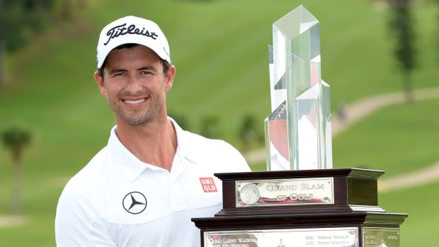 Adam Scott of Australia with the winners trophy after the final round of the PGA Grand Slam of Golf at Port Royal Golf Course on Wednesday in Southampton, Bermuda.