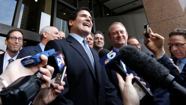 Dallas Mavericks owner and businessman Mark Cuban speaks to the media outside the federal courthouse after he was found not guilty in his insider trading trial in Dallas on Wednesday. Jurors say billionaire Mark Cuban did not commit insider-trading when he sold his shares in an Internet company in 2004 after learning of a development that would dilute the value of his investment.