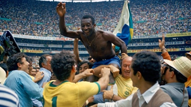 In this June 21, 1970 file photo, Brazil's Pele is hoisted on shoulders of his teammates after Brazil won the World Cup final against Italy 4-1 in Mexico City's Estadio Azteca. If new FIFA rankings are as predicted, the two countries could be taking on each other in the World Cup's opening match in Sao Paulo on June 12.
