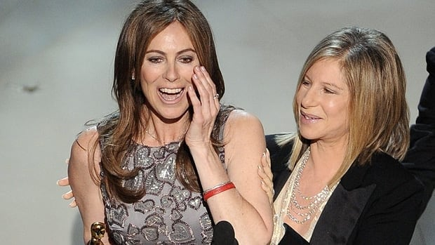 Kathryn Bigelow accepts the Oscar for best achievement in directing for The Hurt Locker from presenter Barbara Streisand at the 82nd Academy Awards on March 7, 2010.