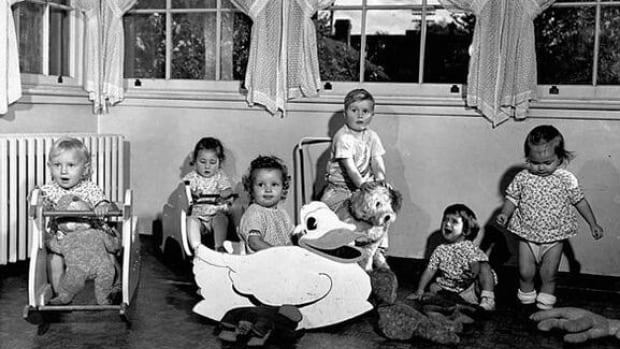 Early baby boomers play with toys at the Ottawa Day Nursery (now the Andrew Fleck Child Centre) in Ottawa, circa 1950. The postwar baby boom in Canada began in 1946 and continued until 1964.