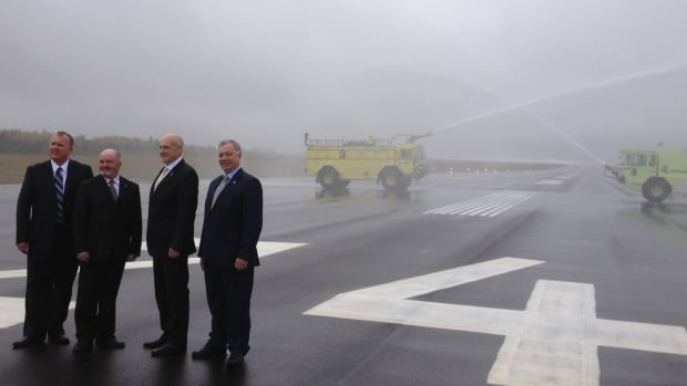 The Greater Moncton International Airport christened it's new expanded runway today. From Left to right: GMIA board Chair Andre Pelletier, Bruce Fitch, Rob Robichaud and Robert Goguen.