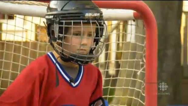 Seven year old Sabastian's Mom says he's excited to be playing hockey, but disappointed he won't be playing with his friends.