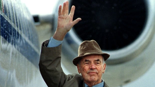Former Nazi officer Erich Priebke, who admitted to having participated in the 1944 massacre of 335 civilians in Rome, was extradited to Italy from Argentina in 1995 to face a war crimes trial. Priebke, seen here leaving Argentina, died last week at the age of 100. His family and lawyer have been clashing with Italian authorities over where to hold Pribeke's funeral.