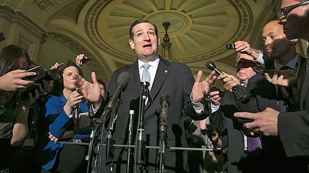 Texas Senator Ted Cruz speaks to reporters outside the Senate chamber on Wednesday while his party leader is expounding inside on a compromise bill designed to end the government shutdown.