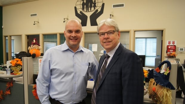 ChangeIt COO Jim Stirtzinger, left, and Mennonite Savings and Credit Union CEO Brent Zorgdrager. The partnership makes the Kitchener-based credit union the first local financial institution to use ChangeIt technology.