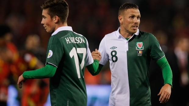 Harry Wilson became the youngest player to play for Wales when the 16-year-old took to the pitch in the final five minutes of a World Cup qualifying match against Belgium Wednesday, making good on a bet his grandfather placed 15 years previous.