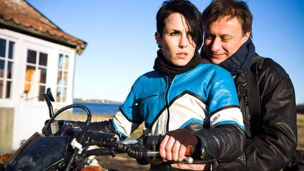 Noomi Rapace, left, and Michael Nyqvist starred in the hit Swedish films based on the internationally bestselling The Girl With the Dragon Tattoo trilogy.