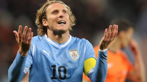 With Luis Suarez out, Diego Forlan could play a key role for Uruguay in their opening World Cup match vs. Costa Rica.