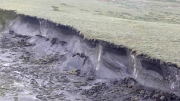 Northern communities will have to spend more to ensure buildings, roadways and other structures can withstand the melting of permafrost, which can cause landslides or 'slumping' as shown in this August 2009 photo from the Mackenzie River delta.