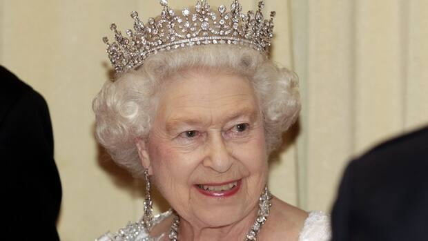 Queen Elizabeth smiles as she greets guests before a state dinner in Toronto on July 5.