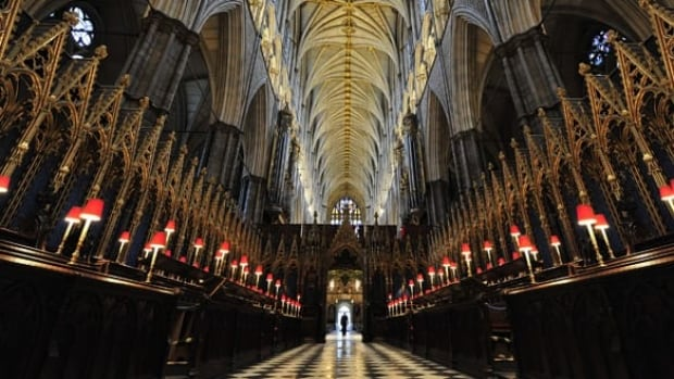 The dean of Westminster, John Hall, walks through Westminster Abbey in central London on Tuesday. Britain's Prince William is to marry Kate Middleton there on April 29.