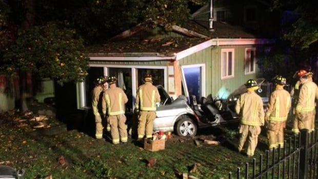 A driver is in custody after a car crashed into this house in Newmarket early Friday.