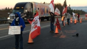 Protesters stand by Highway 125 Friday morning.