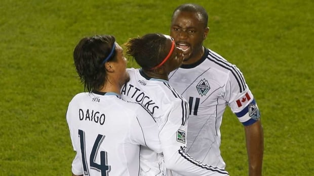 Darren Mattocks, centre, of the Vancouver Whitecaps along with teammates Daigo Kobayashi, left, and Nigel Reo-Coker are hoping they don't run out of time to make the MLS playoffs.
