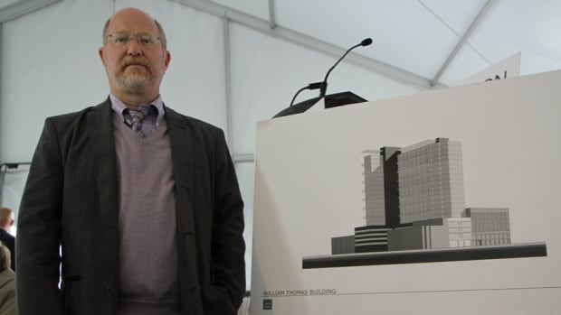 Shawn Marr, director of operations with developer the Hi-Rise Group, stands with an artist's rendering of a proposal for a new James Street North condo development that would incorporate the facade of the old William Thomas Building.