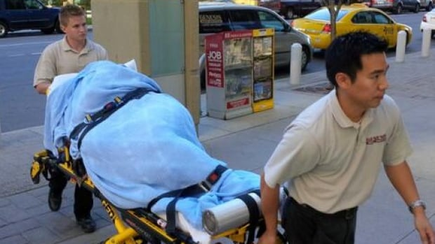 Aset Magomadova enters the court house on a stretcher Friday.