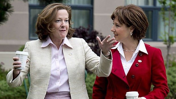 New BFFs? Alberta Premier Alison Redford and B.C.'s Christy Clark stroll for the cameras before a closed-door meeting in Kelowna in June. What a difference a year makes.