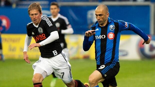 Montreal Impact's Marco Di Vaio, right, breaks away from Philadelphia Union's Brian Carroll in Montreal, Saturday, May 25, 2013.