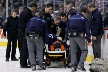 Injured Trouba carried away