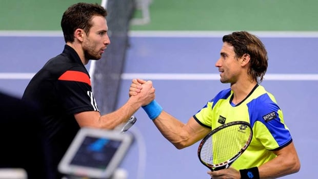 Spain's David Ferrer, right, shakes hands with Latvia's Ernests Gulbis after their semifinal match on Saturday in Stockholm.