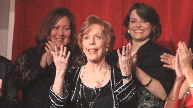 Carol Burnett, centre, is honoured with the Mark Twain Prize for American Humor at the Kennedy Center in Washington on Sunday.