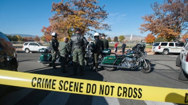 Police secure the scene near Sparks Middle School after a shooting in Sparks, Nev., on Monday morning.  Authorities are reporting that two people were killed and two wounded at the Nevada middle school.