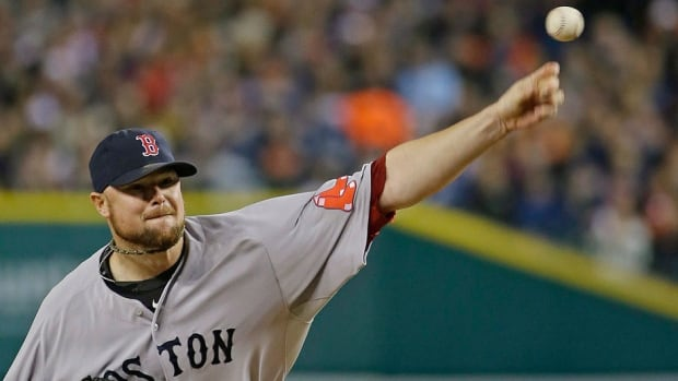 Red Sox starting pitcher Jon Lester, seen here throwing in Game 5 of the ALCS against the Tigers, gets the nod for Game 1 of the World Series versus the visiting St. Louis Cardinals on Wednesday night.