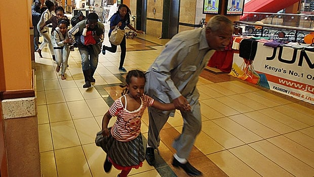 Shoppers and store clerks run for safety after police enter the Westgate mall in Nairobi in September 2013 looking for the extremists who were attacking civilians.