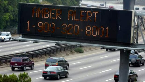 Cars pass a sign, indicating an Amber alert in effect for missing California girl, on the 101 freeway in Los Angeles in 2002.