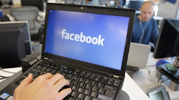 Facebook was criticized by British Prime Minister David Cameron for reversing its policy banning the posting of videos of beheading on the social network. It now says it is working on a method of warning people about violent content.