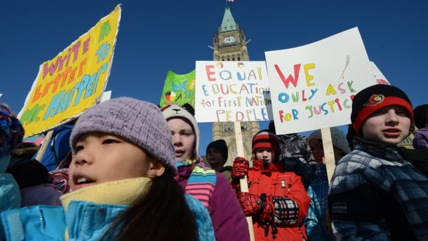 Children take part in a protest calling for equal education for First Nations in this Feb. 14, 2013 file photo taken on Parliament Hill in Ottawa.