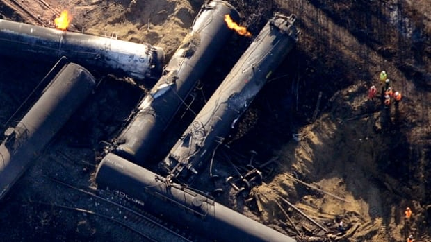 Investigators survey the site of a train derailment near the hamlet of Gainford, west of Edmonton. Residents were allowed to return to their homes Tuesday afternoon.