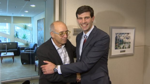 Mayor Stephen Mandel (left) embraces Don Iveson, the two-term city councillor who  was elected Edmonton's next mayor on Monday by a decisive 62 per cent margin.