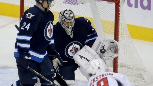 Winnipeg Jets goalie Ondrej Pavelec makes a glove stop on Washington Capitals' Nicklas Backstrom during the first period Tuesday night at the MTS Centre.