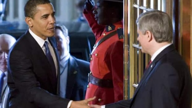 Prime Minister Stephen Harper greets U.S. President Barack Obama upon his arrival on Parliament Hill in Ottawa on Thursday.