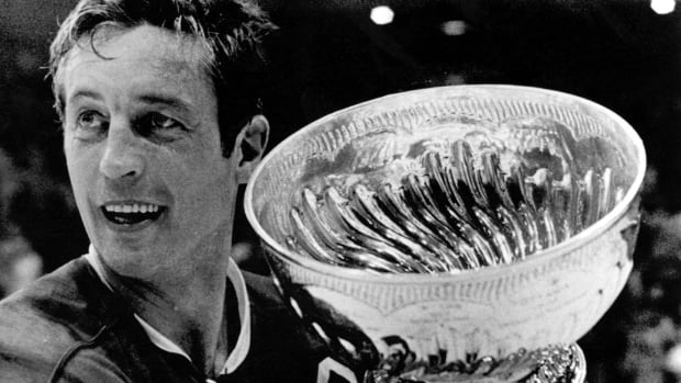 Montreal Canadiens team captain Jean Beliveau holds the Stanley Cup in Chicago May 19, 1971, following the Canadiens' victory over the Blackhawks.