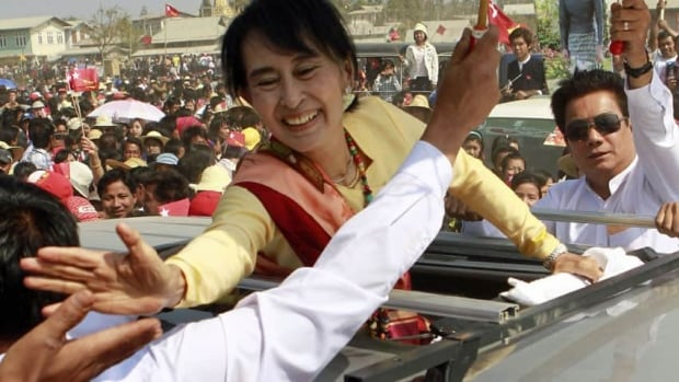 Burma's pro-democracy leader Aung San Suu Kyi greets supporters from her vehicle during her election campaign in Aung Pan in the Southern Shan State of Burma, also known as Myanmar, on March 1, 2012.