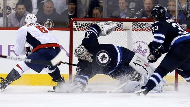 Washington Capitals' Alex Ovechkin scores on Winnipeg Jets' goaltender Ondrej Pavelec during the second period of their game in Winnipeg on Tuesday.