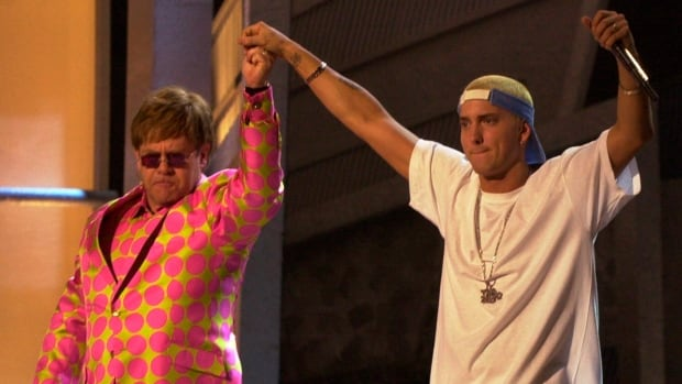 At the Grammy Awards in 2001, Elton John, left, and Eminem performed the latter's hit Stan together. Though the rapper has in recent years said he supports same-sex marriage, he has returned to his earlier practice of spouting offensive lyrics toward homosexuals in his latest song, Rap God.
