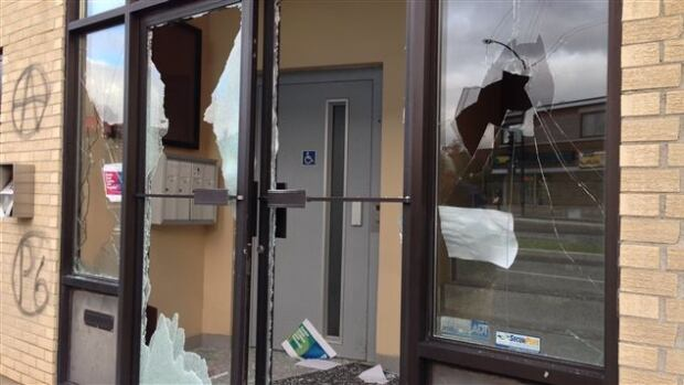 The windows in the building housing Denis Coderre's Rosemont campaign office were smashed and walls were spray-painted with graffiti.