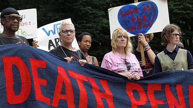 Civil rights and anti-death penalty activists take part in a demonstration in an Atlanta park following the stay of execution granted Warren Hill in July 2013.